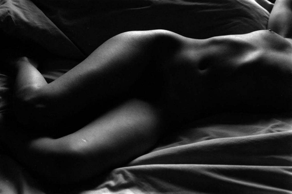 Madeleine on bed 2 (Low-key) Rod Fleming 1985